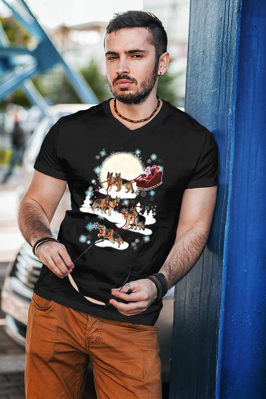Santa Clause in Christmas pulling the dog shirt unisex